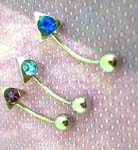 Body piercing wholesale supplier. Spike eyebrow rings with colored cz gems attached to sterling silver curved barbell
