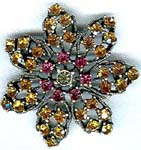 Best wholesale jewelry supply store. Cz crystal fashion brooch in star flower design with pink and amber colored gems
